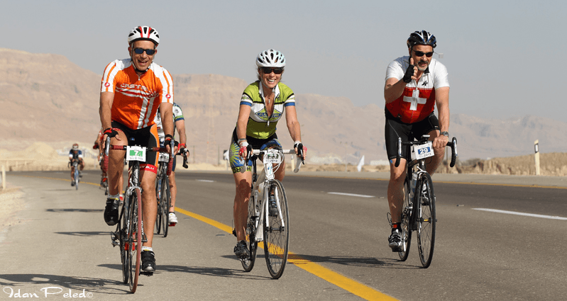 Dr. Marty Cole (in the orange jersey) rides along the Dead Sea. (Photo: Idan Peled.)